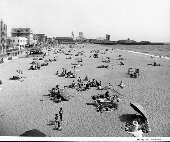1939 - Venice - People relax on the beach in the sun and under umbrellas 2