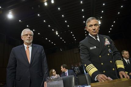 Assistant Defense Secretary of Defense for Asian and Pacific Security Affairs David Shear, left, and Adm. Harry Harris, Jr., US Navy Commander, U.S. Pacific Command, take their seats on Capitol Hill in Washington, Thursday, Sept. 17, 2015, prior to testifying before the Senate Armed Services Committee hearing on maritime security strategy in the Asia-Pacific region. (AP Photo/Cliff Owen)